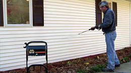 clean siding with pressure washer